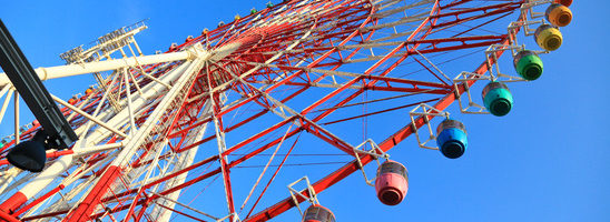 the Ferris wheel with the blue sky background.