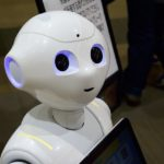 Robots for Students with Autism vs. Real Therapists and Teachers